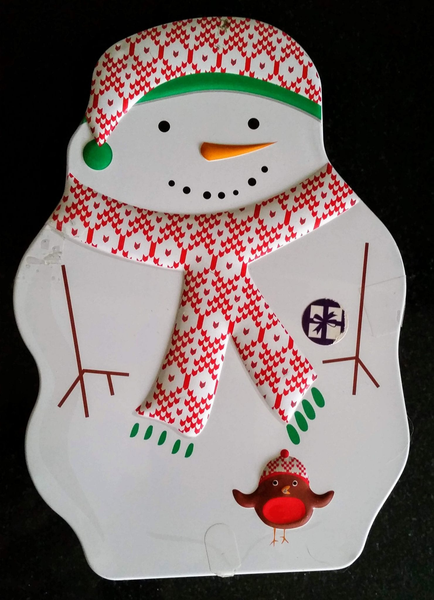 A snowman-shaped biscuit tin