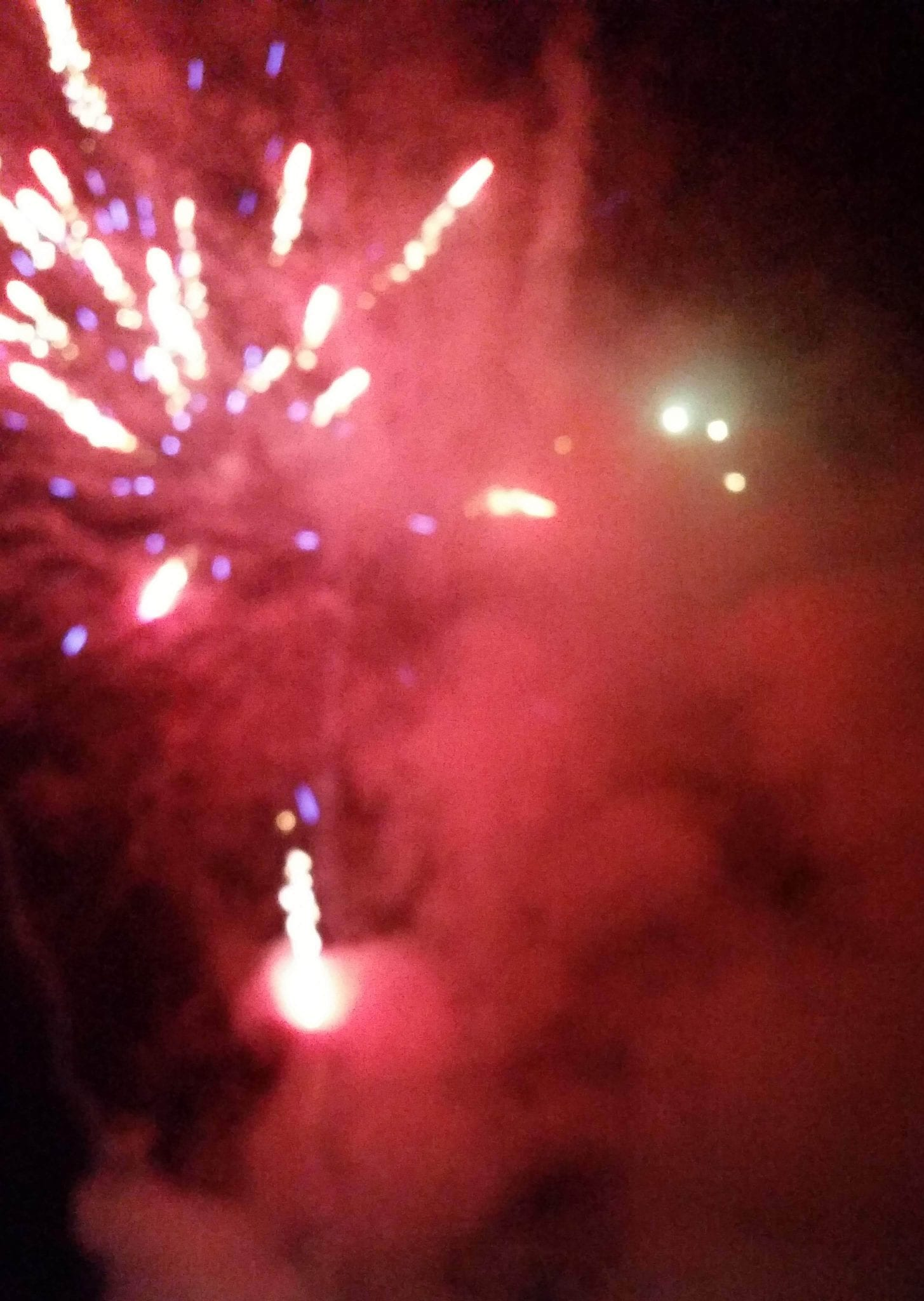 Fireworks and red smoke