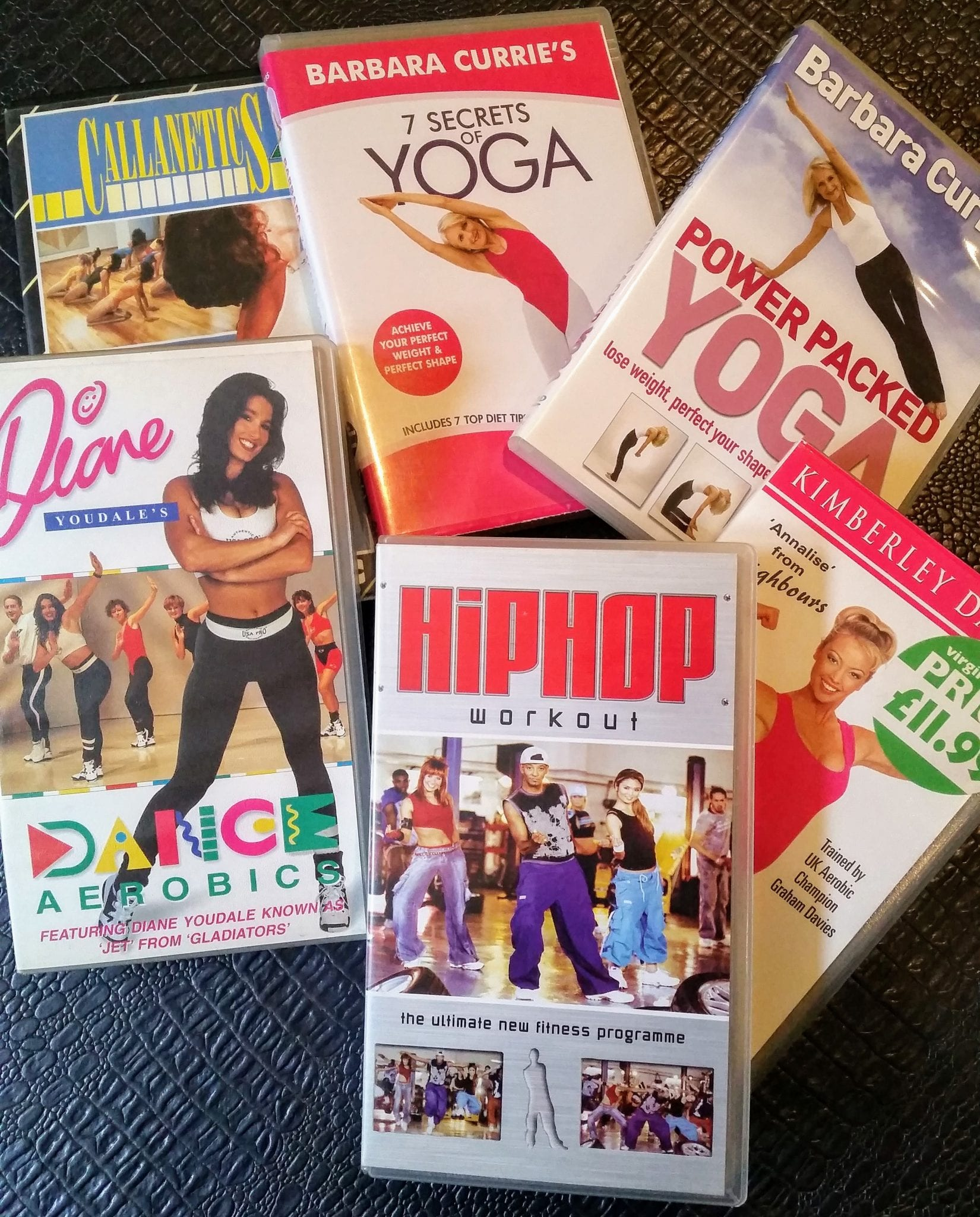 An assortment of yoga and workout video tapes and DVDs